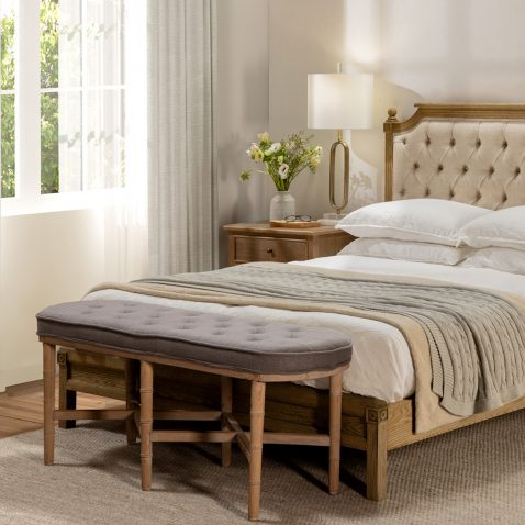 Grey tufted bed end with 6 legs