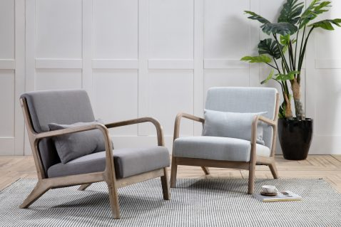 Lounge chair upholstered in grey linen fabric with wooden arms and legs