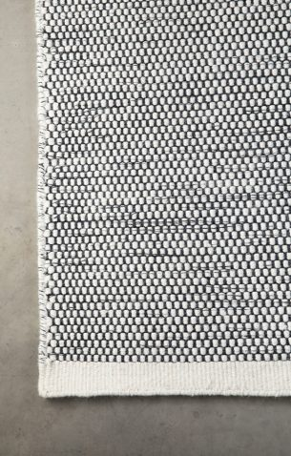 Block & Chisel white/black wool rug with white trim