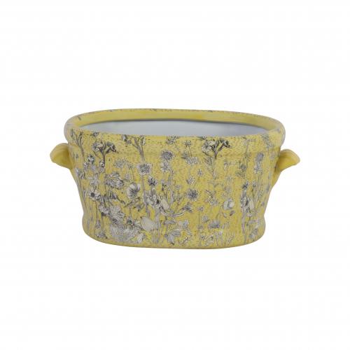 yellow ceramic footbath with daisy