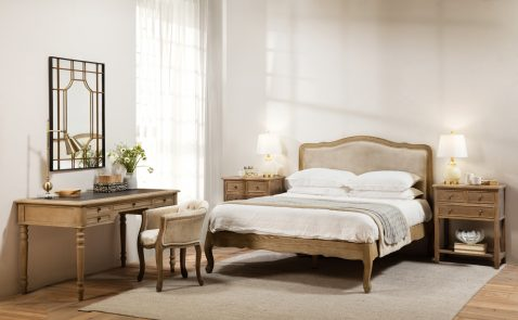 Upholstered french style bed with oak frame