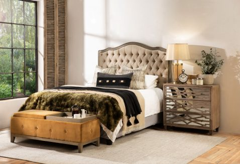 Cleopatra Bedend in old gold with tufted detail and wooden legs with convertible trays