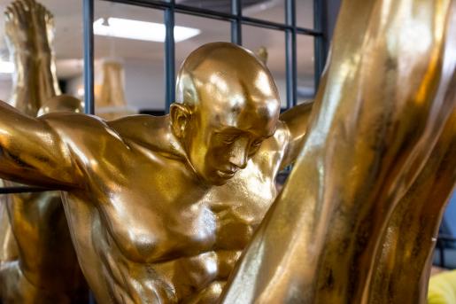 golden driver in mid air statue in mini plinth