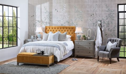Cleopatra Bedend in mustard with tufted detail and wooden legs with convertible trays