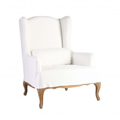 White wingback chair with brown wooden legs