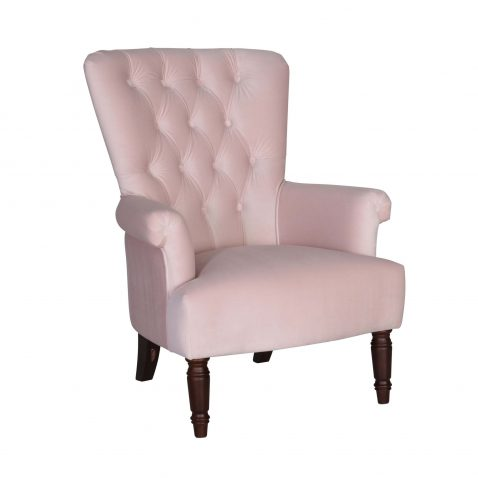 pink velveteen armchair with high tufted back and wooden legs