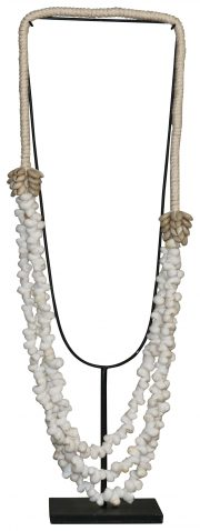 Block & Chisel shell necklace on metal stand