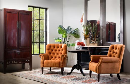 Block & Chisel orange velvet upholstered lounge chair