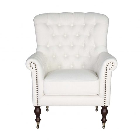 white tufted armchair in classic vanilla