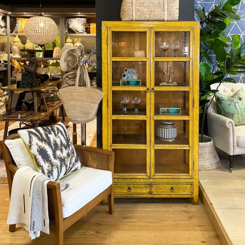Yelllow chinese cabinet with glass panes and 2 drawers