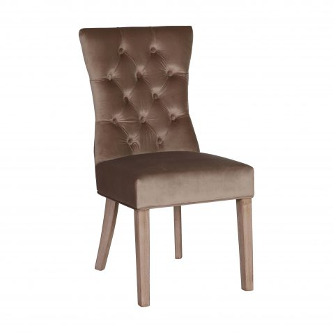 Upholstered brown velvet dining chair with button back detail and wooden legs.