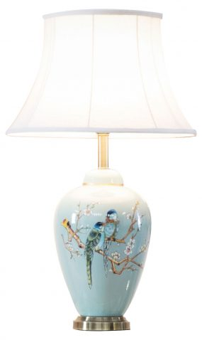 Light blue background with birds and twigs design lamp and white lampshade
