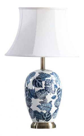 Floral blue and white china lamp base with white lampshade and brass trim