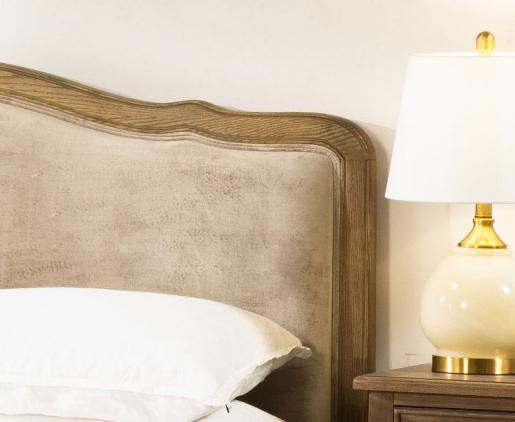 upholstered bed with oak frame