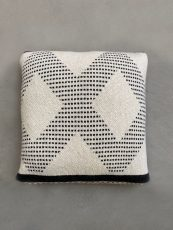 white knitted cushion with black diamond