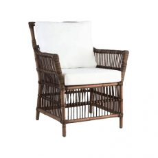 Block & Chisel rattan armchair with white cushions
