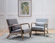Grey linen mid-century lounge chair with wooden frame and scatter cushion