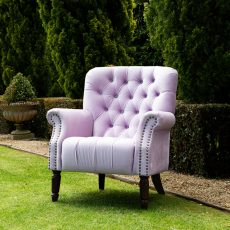 fully upholstered lounge chair with deep button back with wooden legs.