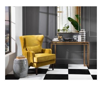 wingback chair in gold velvet