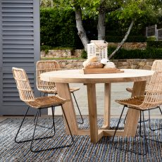 Rattan dining chair with black steel legs.