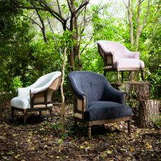 Deconstructed occasional chair with castors, upholstered in charcoal fabric