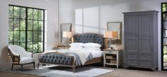 french style bed with buttoned detail in grey fabric