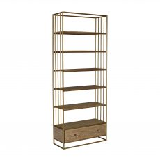 Block & Chisel bookshelf with gold metal frame and wooden shelves on castors