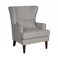 Wingback chair in grey speckle fabric with stud detail