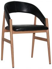 Block & Chisel black faux leather dining chair with pointed wooden legs