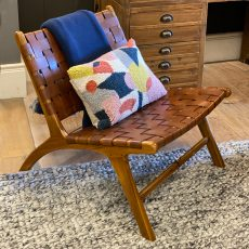 Leather strap chair with teak frame.