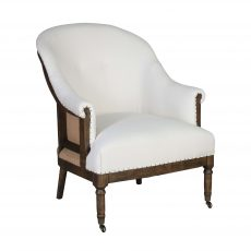 Deconstructed occasional chair with castors, upholstered in ivory fabric.