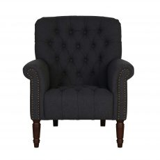 fully upholstered lounge chair in charcoal with deep button back dark stained legs.