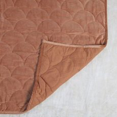 Quilted throw in clay