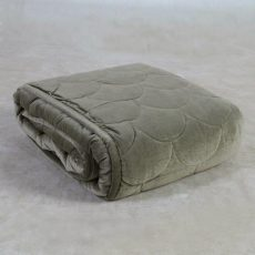 Quilted throw in sage