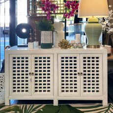 wood sideboard in white with lattice detail on doors