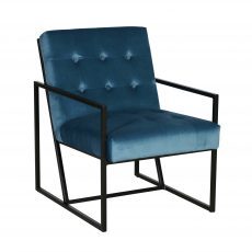 Blue velvet occasional chair, buttoned detail back with black metal frame.