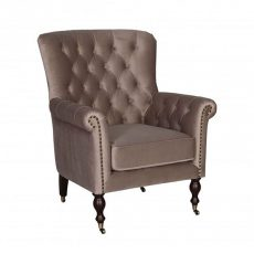 Champagne velvet tufted occasional chair with wheel feet