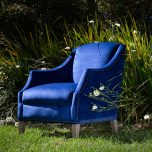 Vera Armchair in blue velvet and studded trim detail