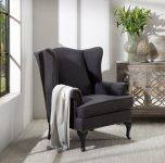 Wilma Wingback chair with nailhead details and wooden legs in charcoal