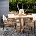 rattan armchair with off white cushions