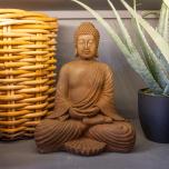 Rustic buddha statue in meditative postion