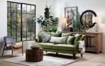 3 seater fully upholstered sofa in green fabric with loose back cushions on queen anne wooden legs.