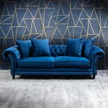 Persian blue chesterfield sofa with loose back cushions