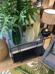 metal and glass console with bottom shelf