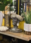 African tribal head statue with cream headgear and dark skin