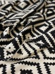 black and white geometric knitted throw