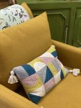 Geometric scatter cushion with tassels