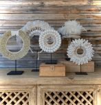 Block & Chisel shell and feather necklace deco on metal stand