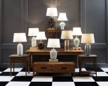 Black base with gold oriental nature pattern and white lampshade