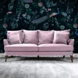 3 seater fully upholstered sofa in lilac fabric with loose back cushions on queen anne wooden legs.